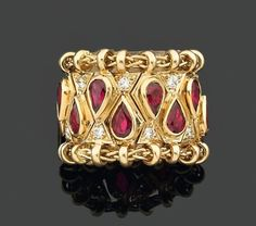 """""""Passementerie"""" ring by René Boivin set with pear-shaped rubies and brilliant cut diamonds, 1949."""