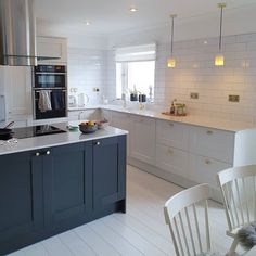 Bring your two toned kitchen cabinet ideas to life with our Fairford Navy Kitchen and Fairford White Kitchen! Pair with pendant lighting and white kitchen tile ideas to finish off. White Shaker Kitchen, Navy Kitchen, Kitchen Layout, Shaker Style Kitchens, Kitchen Tile, Howdens Kitchens, Home Kitchens, Home Decor Kitchen, Kitchen Interior
