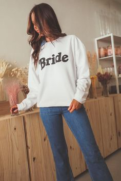 Bridal 2021 is LIVE !! Shop the collection at www.shopriffraff.com & find the perfection pieces for the bride in your life #bridal #wedding #bride #wifey Live Shop, Graphic Tees, Graphic Sweatshirt, Wedding Season, Wedding Bride, Big Day, Bridal, Sweatshirts, Sweaters