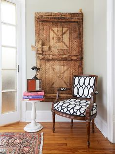 A door from Saudi Arabia is the backdrop to this reupholstered chair. Both give this reading nook a collected look. #hgtvmagazine http://www.hgtv.com/design/decorating/design-101/the-perfect-mix-of-his-and-hers-pictures?soc=pinterest