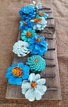 Painted pinecone flowers on reclaimed barn wood