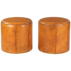 Vintage Pair of French Leather Ottomans or Poufs, circa 1950s | See more antique and modern Ottomans and Poufs at https://www.1stdibs.com/furniture/seating/ottomans-poufs