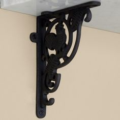 """Little Rooster Cast Iron Shelf Bracket - 4-1/8"""" x 5-1/4"""" - Black Powder Coat by Whittington Collection. $6.95. Add a piece of classic country style to your home with the Little Rooster Cast Iron Shelf Bracket. Shown in Rust finish. Bracket dimensions: 4-1/8 L x 5-1/4 H. Bracket is 5/8 wide; 1-1/2 wide where the mounting screws are placed. Made of durable cast iron. Rust finish is actual oxidized iron, a living finish. Sold individually. Includes matching fastening hardware."""