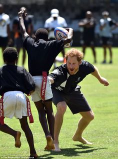 Barefoot and ready to play! The rugby-loving prince, who watched many of the matches at la...