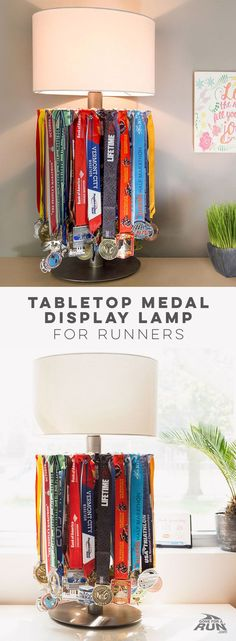 Surprise a favorite runner or treat yourself to this unique combination of a tabletop medal display and lamp that's perfect for runners who love to share the story of all their medals that make up the fabric of their personal journey as a runner.