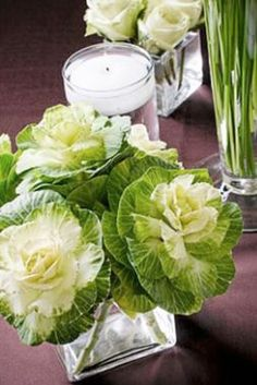It's Fall!  a simple vase of ornamental cabbages makes a seasonal statement. try adding a few tiny gourds by the vase or adding a sprig of fall berries with the cabbages.