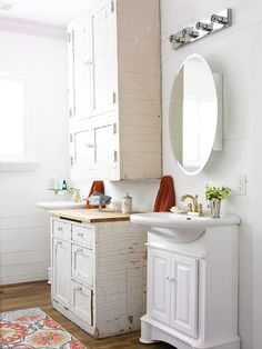 A Comfy Cottage Makeover with Vintage Style    Vertical Space: The cottage's ceilings are high, so the tall bathroom cabinet works wonders to make the most of vertical space. The crackle paint on the cabinet provides a nice contrast to the flat white sink and is a trademark cottage patina.