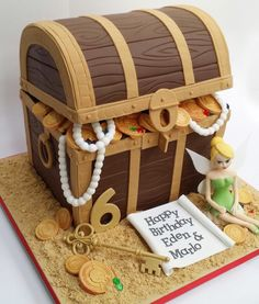 Treasure chest pirate cake with Tinkerbell, pearls and coins
