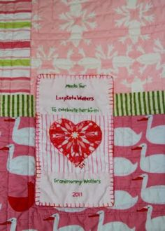 I love the idea of a quilt label...definitely doing this on my next one.
