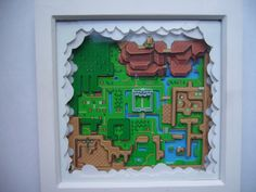 3D Art Diorama - Legend of Zelda Hyrule Map This is a hand crafted 3D Art Piece based on the Hyrule map from Legend of Zelda - A Link to the Past on the Super Nintendo  It is hand made in England ( by me! ) ... the wood frame measures 9 inches x 9 inches with a 1.5 inch depth, and has a glass frontage.  The map from Zelda is printed on high quality super glossy paper many times, and is precision hand cut and built up in 3D to give the 3 Dimensional Effect of looking down onto the map…
