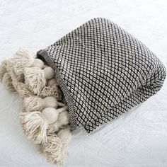 Note: this blanket is made to order. It usually take 3-4 daysfor the blanket to be woven and and 4-5 days to be delivered. Our beautiful Moroccan Pom Pom blankets are hand loomed in Morocco using traditional wooden looms in a tradition that is inherited from generation to generation. These blankets are a perfect addi Moroccan Decor Living Room, Moroccan Bedroom, Moroccan Interiors, Dream Blanket, Black Blanket, Manta Crochet, Black Pattern, Decoration, Bedroom Decor