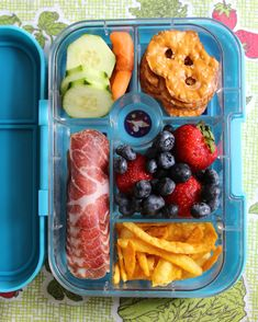 Go Bento! These Kids Lunch Box Ideas Will Inspire You | Whether it's back to school and you need lunch box help or halfway through the school year and you're out of ideas, these bento bxoes will help you make clever and easy creations! Lunch never looked so good before-and your kids are sure to agree! Try this A Box of May Bites-full of a little bit of everything from salami to veggies and fruits to pretzels.  #food #backtoschool #marthastewart #kidslunchideas