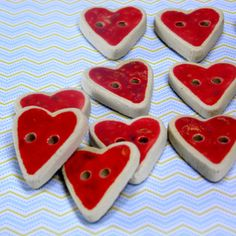 This item includes a set of 4 little heart ceramic buttons. These red buttons are perfect as craft Supplies, beading Supplies, and jewelry supplies. Imagine these red ceramic buttons on your little girl or grandchilds sweater... arent they the most cute buttons?!! Notice, that these are hand made so they never are identical.  This is a ceramic and pottery hand made in Israel, made of white clay and hand painted carefully with spotted red glaze (one side only).  ***Pay attention to the size…