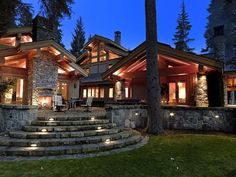 Mountain Retreat: The back of the home has a stone patio that leads onto the grounds.