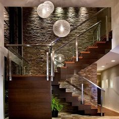 Natural #materials, neutral #colours, water features and lighting all contribute to making this #home feel warm and relaxed  http://www.onekindesign.com/2013/10/08/sophisticated-modern-dream-home-winter-park/
