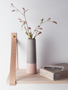 Made from clay with a rustic textured concrete grey finish and blush glazed base, this slim petite vase is designed to stand out from the crowd. Whether displayed alone or filled with little flowers, our weighty dipped vase adds a touch of the concrete trend with a hint of colour to your home.