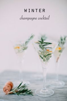 Winter Champagne Cocktail: pour champagne into glasses - add 1 dash of orange bitters, a squeeze of orange juice and garnish with orange peel and rosemary.