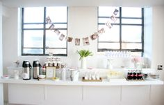hot chocolate station with customized stickers and whipped cream and different creamer flavors to add