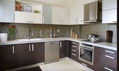 Comfortable modern kitchen in dark wood and metallic - homeyou ideas #kitchen #modern #interiordesign #cabinets