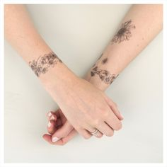Delicate daisy chain and flower head temporary tattoos. Adorn yourself with…