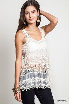 This sheer lace tank is perfect for layering. Add a touch of lace by pairing with a cardigan or vest. This racerback tank also looks great on its own when worn with a bandeau or bralette.