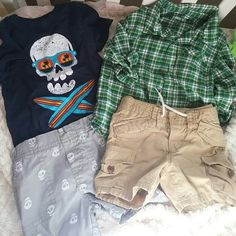 4pc 12-18months boys 2 tops 2 shorts  Blue surf skull shirt sleeve tee with matching grey with white skull long board pull on shorts with 2 pockets By circo worn 1 x EUC SIZE 12-18MONTHS  Green light weight plaid button down by Cherokee  Size 18months never worn new prep washed only  Tan cargo shorts By baby gap size 12-18months EUC 4 pockets with 2 additional cargo pockets totally cute   Baby boys Baby gap + circo Other