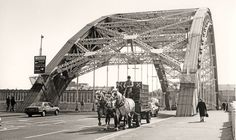 https://flic.kr/p/baowHr   Vaux dray   The Vaux Brewery in Sunderland was in business between 1837 until acquired by Whitbread in 2000. Horse-drawn drays were used until the end. This pair are crossing the Wearmouth Bridge in 1985.  Pentax SP1000/50mm Ilford FP4