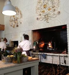How cool ar those relifes on the wall??!!  Bar Sajor Wood Fired Oven, Remodelista