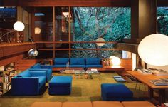 Living Room, Frank Llyod Wright inspired architecture with modern furniture