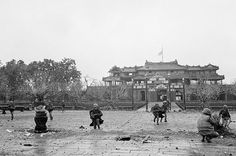 U.S. Marines and South Vietnamese troops move through the grounds of the Imperial Palace in the old citadel area of Hue, Vietnam, on February 26, 1968, after seizing it from Communist hands. The heavy damage was the result of the artillery, air, and mortar pounding the area received for 25 days while the Viet Cong/NVA held the area. (Eddie Adams/AP) ~ Vietnam War