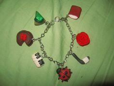 Katie's charm bracelet by Sarah-Leigh17400 on DeviantArt