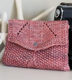 "Free Knitting Pattern for Sundance Bag - Clutch with flap in seed stitch. 7"" wide x 4½"" tall. Worsted weight wool yarn. Designed by Joëlle Meier Rioux. Pictured project by BetsyJo"