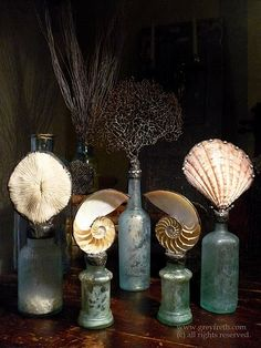 Love this vintage look with pretty shells - got lots of old bottles and lots of shells - will have to try - will be perfect for my BR