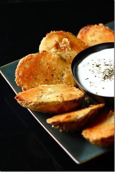 Parmesan Baked Potato Halves. Potatoes + garlic + butter + parmesan cheese. What's not to love?