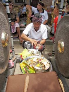Blessing the gamelan instruments before they perform their sacred task - being played at a family temple ceremony in Lodtunduh, south of Ubud, Bali, Indonesia. Photo by Indounik 2013