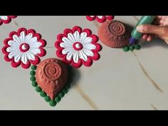 Easy and beautiful rangoli design for Diwali 2019 | Unique Rangoli design | Rangoli using diya - - YouTube Rangoli Designs Latest, Rangoli Designs Flower, Rangoli Patterns, Small Rangoli Design, Rangoli Border Designs, Rangoli Ideas, Rangoli Designs Diwali, Rangoli Designs With Dots, Rangoli Designs Images