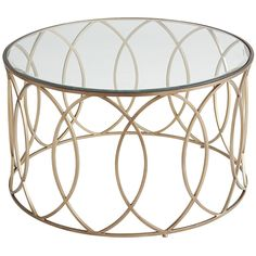 "The newest starlet to feature in your living room? Our Elana Coffee Table. Graceful and topped by beveled glass, her hand-forged geometric design works well with any supporting cast of furniture. Also known as the ""it goes with anything"" factor."