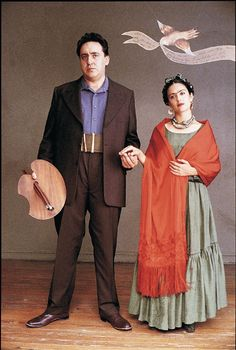 Frida (2002), Julie Weiss (Costume Designer), Salma Hayek (actress)    Salma Hayek as Frida Kahlo and Alfred Molina as Diego Rivera replicate one of Frida's paintings in Julie Taymor's 2002 film.