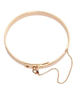 Eddie Borgo Safety Chain Choker: Rosegold: This piece from Eddie Borgo is quite a statement. The choker/collar has a hinged front with a chain-laden layered lobster-claw clasp closure detail. Measures: 4″. In rose gold tone. Made in ...