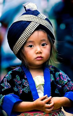 A Hmong girl wearing traditional clothes during Hmong New Year celebrations in Luang Prabang, Laos.