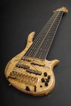 Combat Guitars, 10-String Electric Bass. Does anyone know how you actually play this beast? You must have to reach from the top to play those top strings?!