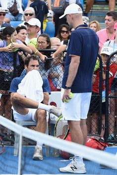 Roger Federer Photos Photos - Roger Federer of Switzerland speaks with his coach Ivan Ljubicic during day one of the 2016 Brisbane International at Pat Rafter Arena on January 3, 2016 in Brisbane, Australia. - 2016 Brisbane International - Day 1