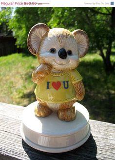 On SALE Mint Condition Ceramic Otagari Kirby Koala Music Box That Plays Love Makes the World Go Round Circa 1985. $35.00, via Etsy.
