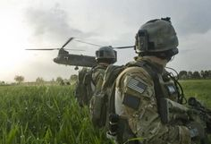 US Army Rangers watching a CH-47 Chinook lift off.