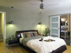 affordable bedroom make over  love the door and the lucite ceiling fan