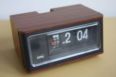 Flip clock... there is something so satisfying about the sound of the numbers flipping over.