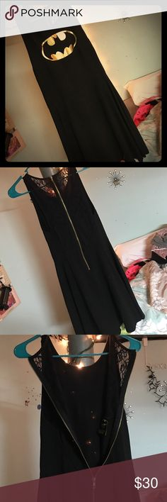 """""""Batman"""" dress All black sleeveless """"batman"""" dress. The upper back of the dress is all lace with gold zip up. And Batman symbol on the front. Worn once! Batman Dresses Midi"""