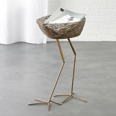 Shop bird basket side table. Feather your nest with a surrealist side table for a song. Handcrafted by artisans, long-legged metal base supports a basket perfectly sized for mail, magazines or other nest materials.
