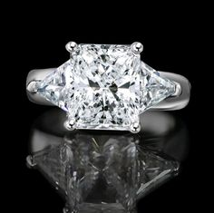 6 CT. Radiant Rectangular Classic wide shank ring w/Zirconite triangular sides(1 CT. TW.) simulated diamond - Diamond Veneer.