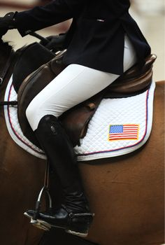 Perfect seat, legs and feet...wait, why didn't someone wipe her boots ?!?! She is riding for the USA !!